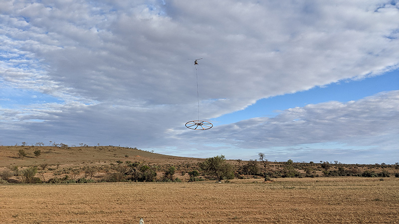 Helicopter and sensor performing an airborne electromagnetic survey